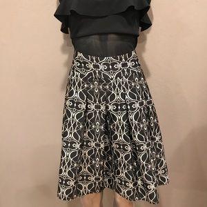 Satin finish Long pleat print skirt